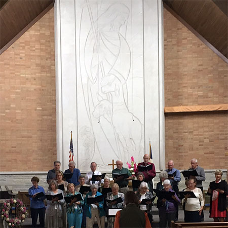 Sturgeon Bay UMC choir performing alongside the church altar
