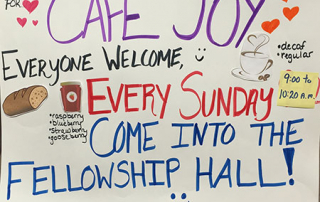 Colorful sign welcoming Sturgeon Bay UMC visitors to Cafe Joy